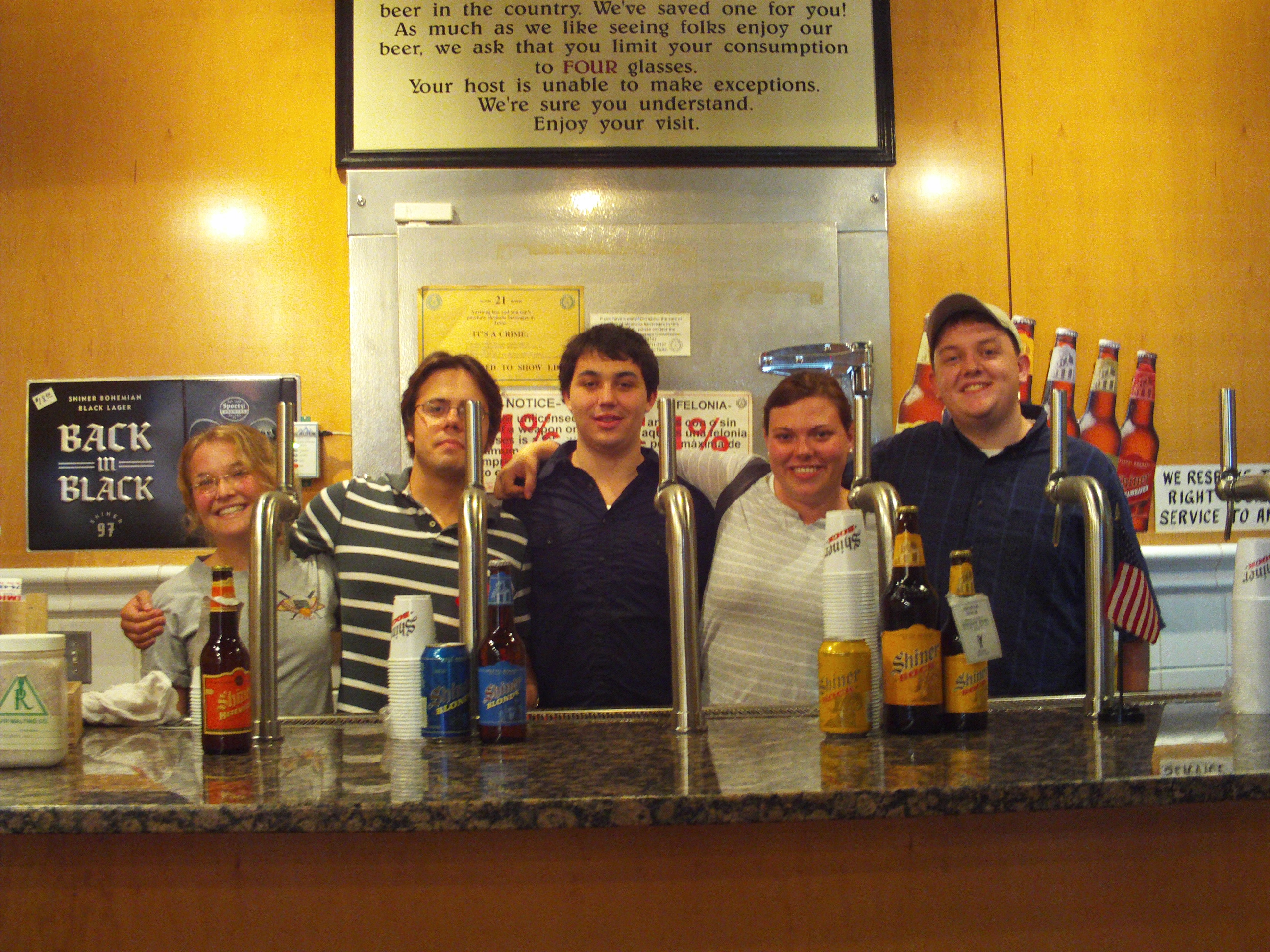 My friends and me behind the bar at Shiner Brewery